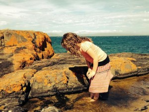 Girl and rock pool