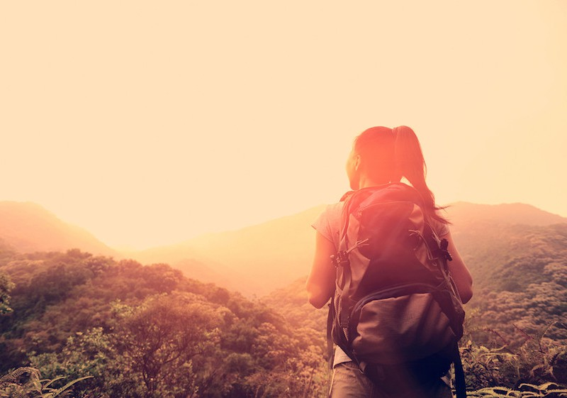 Woman hiking in mountains. From Shutterstock.