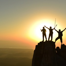 Hikers at top of mountain, Shutterstock.