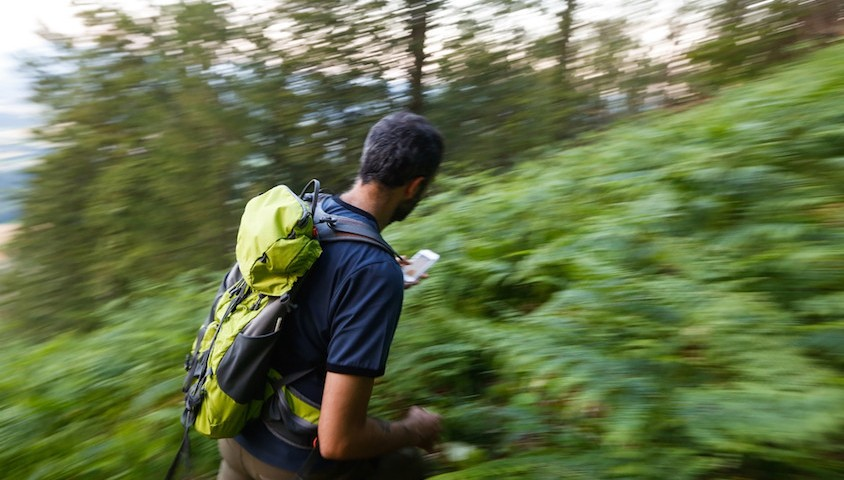 Hiker uses GPS to navigate.