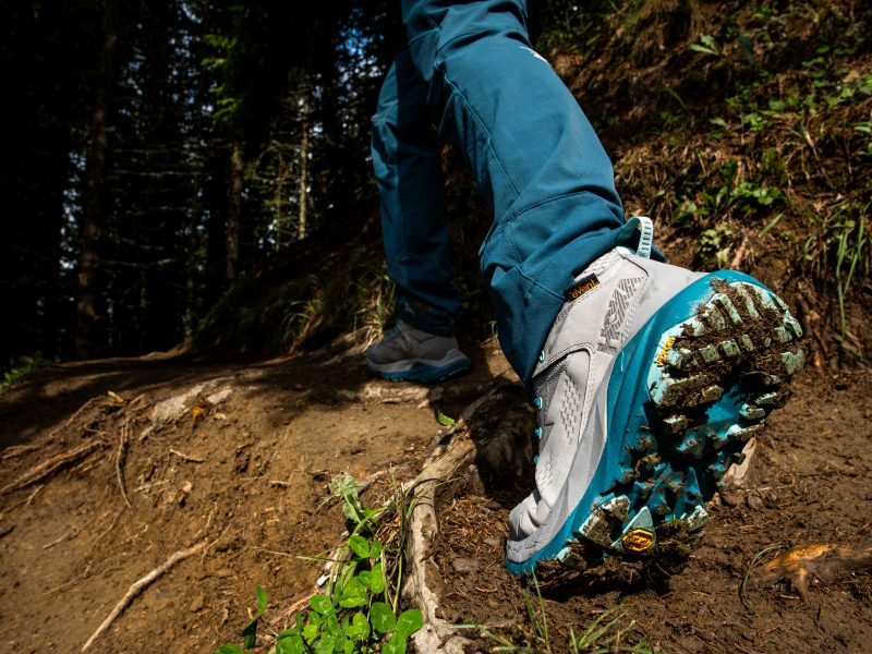 Close up shot of shoe in action on trail